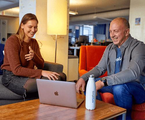 Man & Woman looking at Laptop